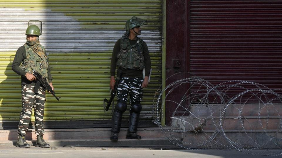 Security personnel at a barricade during restrictions placed on movement on the occasion of Muharram, in Srinagar, Jammu and Kashmir, India on Tuesday, September 10, 2019.