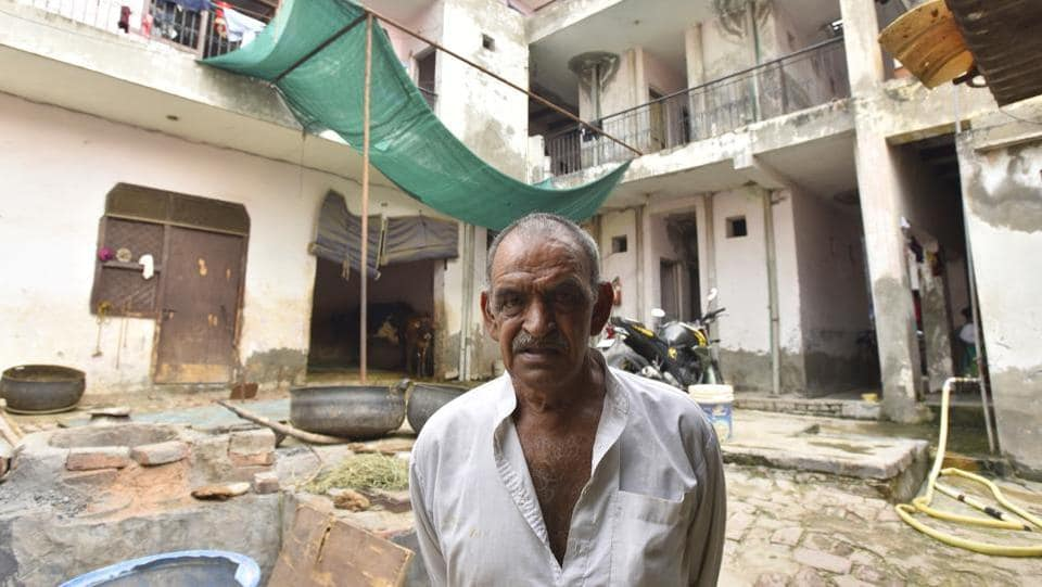 "The villagers say the slowdown is beginning to ruin the rental economy of the village. ""Tenants are leaving our rooms like never before… There have been no takers for the vacated rooms in the past month,"" said Rampal, in the courtyard of his tenement, which has over a dozen rooms. ""Most of my tenants are contract or casual workers with low salaries. They cannot afford a house anywhere else."" (Sanjeev Verma / HT Photo)"