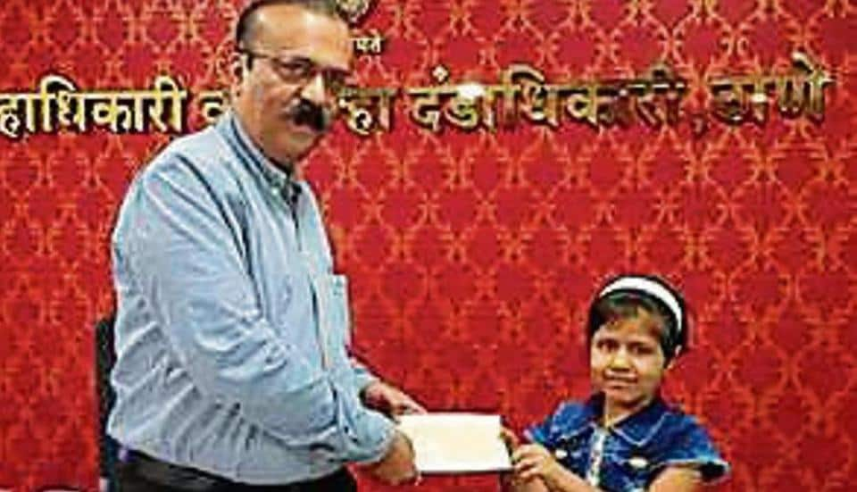 """Kirankumar Chavan, 42, a lecturer at a junior college in Thane, said, """"Kartiki is very active. She is good at drawing and manages to bag a prize every time she participates in a competition."""""""