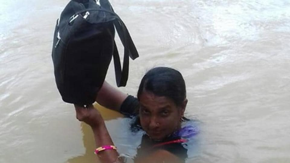 Teacher Binodini Samal risks her life everyday in the monsoons and wades through Sapua river in Dhenkanal district of Odisha to reach the primary school.