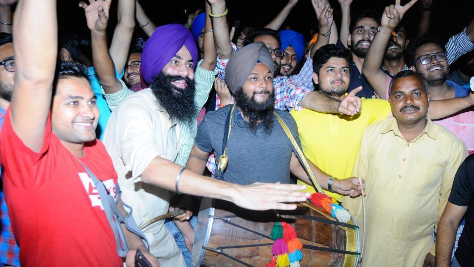 Members of NSUI celebrating after their candidate emerged winner following recounting.