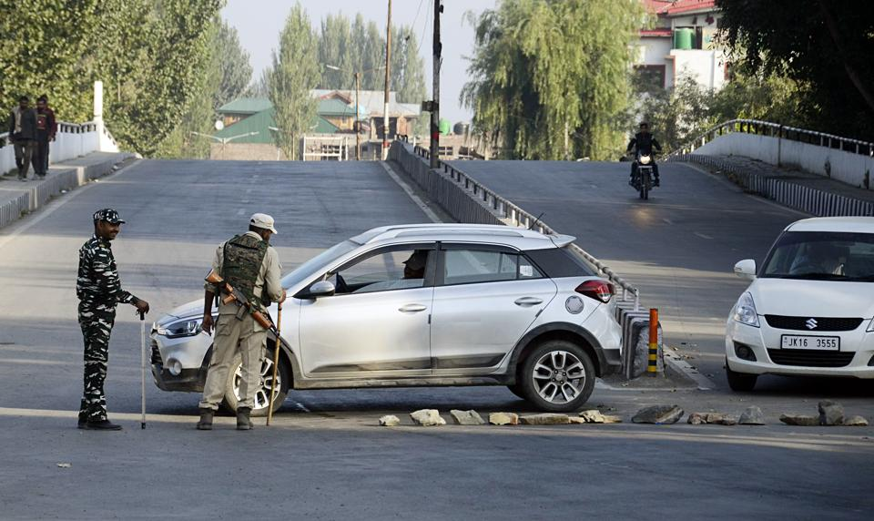 CRPF personnel stop vechiles during restrictions in Srinagar on Tuesday.