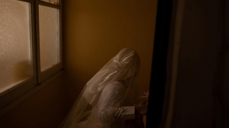 Hanin, 19, leaves her friend's apartment in her wedding dress ready for her marriage to Ahmed in Izmir. Living in different cities, they exchanged text messages for months before Ahmed met her, which led to their engagement. Their engagement party was in Kilis, right across the border from war-torn Syria. (Ekaterina Anchevskaya / REUTERS)