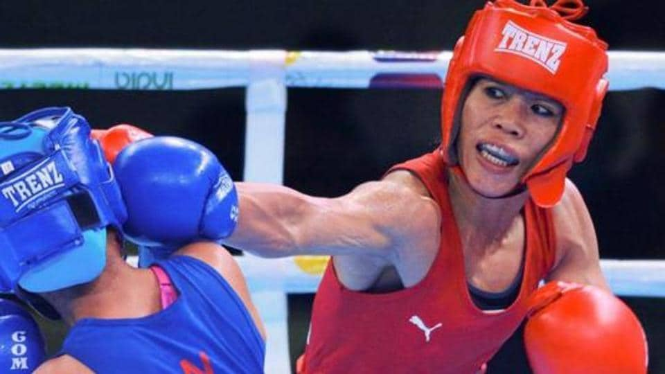 Mary Kom (R) punches Nepal's Mala Rai after their bout.