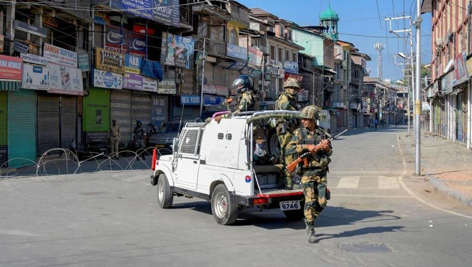 Security personnel stands guard at a  road in Srinagar on Monday, September 9, 2019.