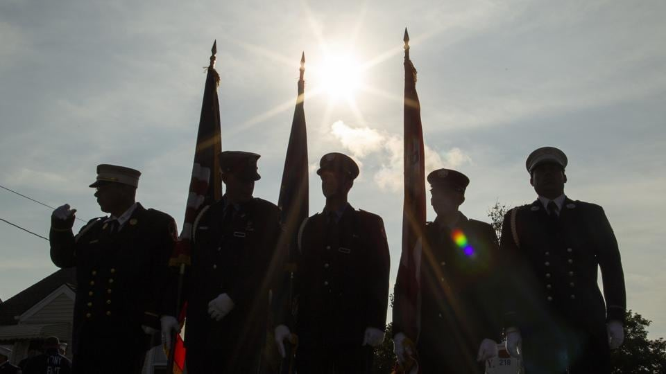 Americans are commemorating 9/11 with mournful ceremonies, volunteering