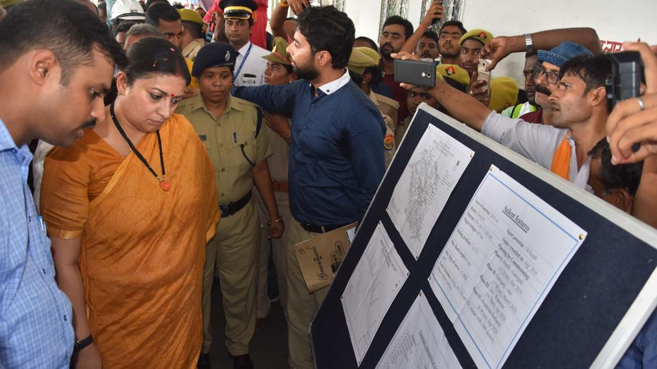 Railway officers explain progress on electrification and double line project of train from Amethi to Gauriganj railway station to Union Minister and Amethi MP Smriti Irani, in Amethi.