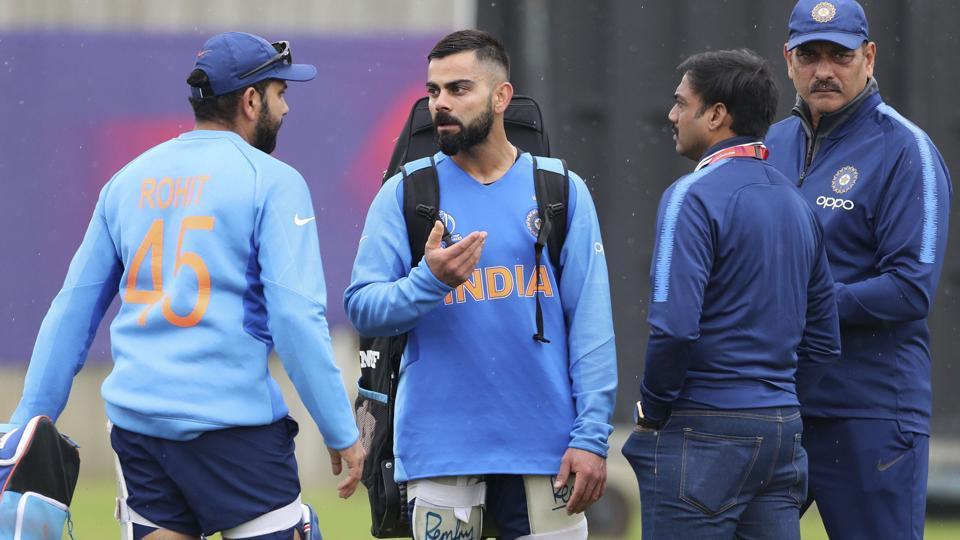 MSK Prasad, second right, and Ravi Shastri, right, listen as India's captain Virat Kohli, second left, talks to teammate Rohit Sharma.