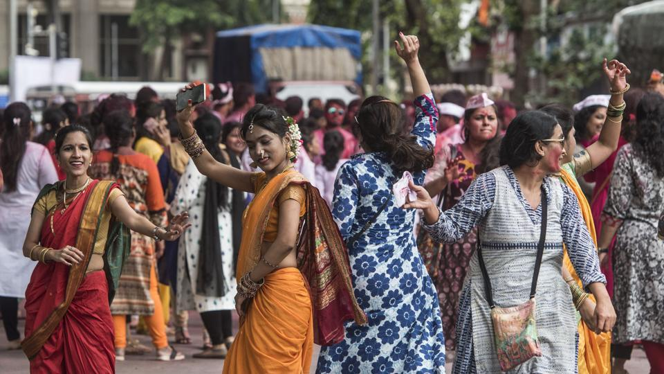 Revellers dance during a visarjan procession in Mumbai. The festival is synonymous with the sounds of 'Ganpati Bappa Morya' chanted by devotees in processions throughout the 10-day period, calling the deity back to their homes as soon as possible next year. (Satyabrata Tripathy / Ht Photo)