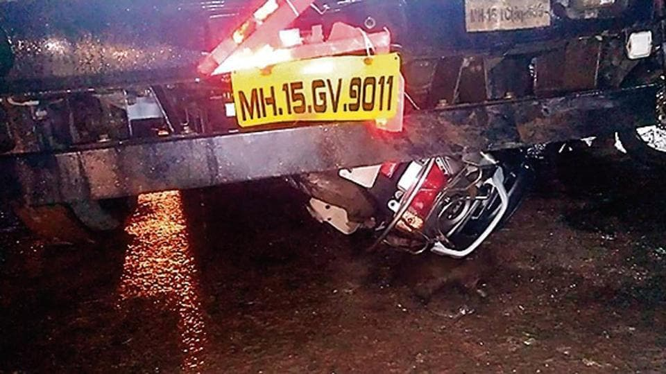 One of the two-wheelers went under the truck in the accident on Pirangut ghat, on Tuesday night.