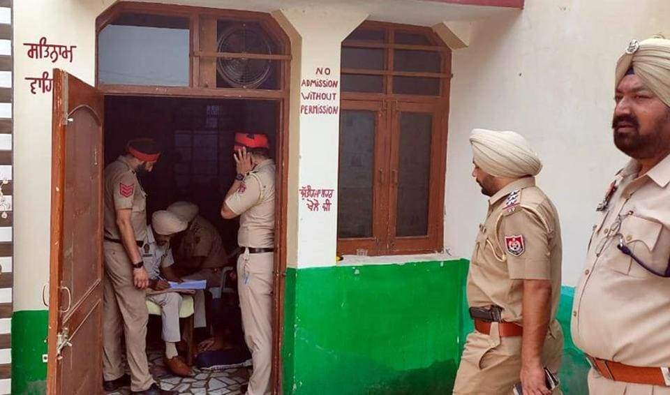 Police conducting raid at the illegal drug de-addiction centre, which was being run in the name of a Khalsa Welfare Foundation, at Panjoli Khurd village in Fatehgarh Sahib on Thursday.