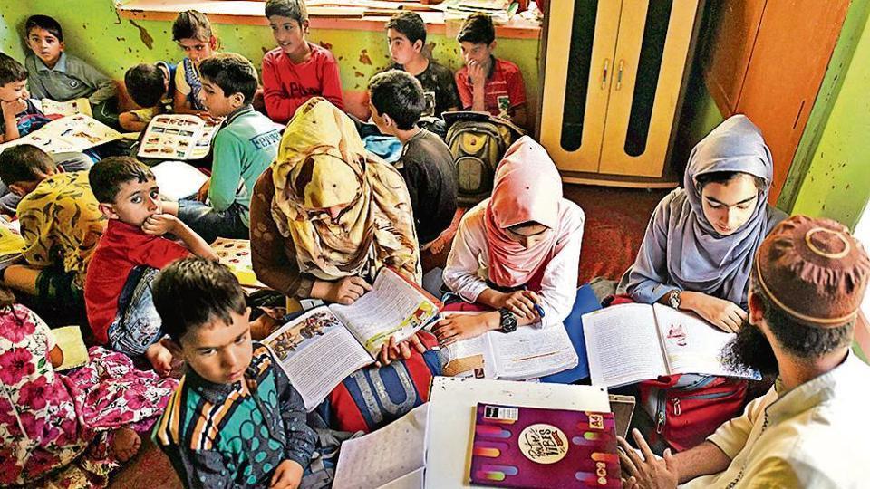 Children attend tuition classes in Srinagar.