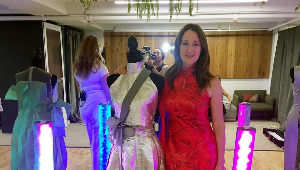 Clare Tattersall poses with some of her creations her at the Robotic Dress Exhibition on September 9, 2019 in New York. - Perfect for the post #MeToo era, on the catwalks of New York Fashion Week paraded a dress with metal leaves on one shoulder that shake and tinkle when someone gets too close.