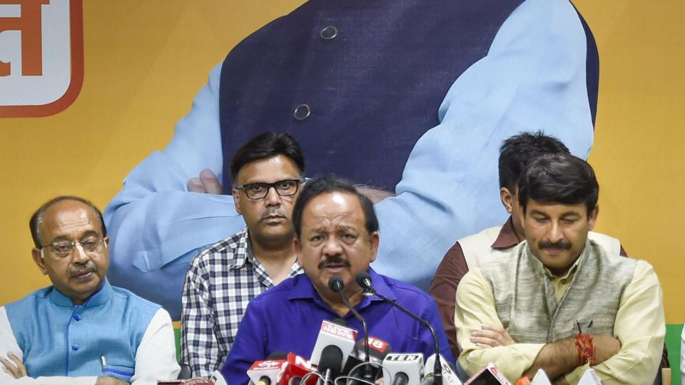 Union Health Minister Harsh Vardhan addresses a press conference with Delhi BJP President Manoj Tiwari.