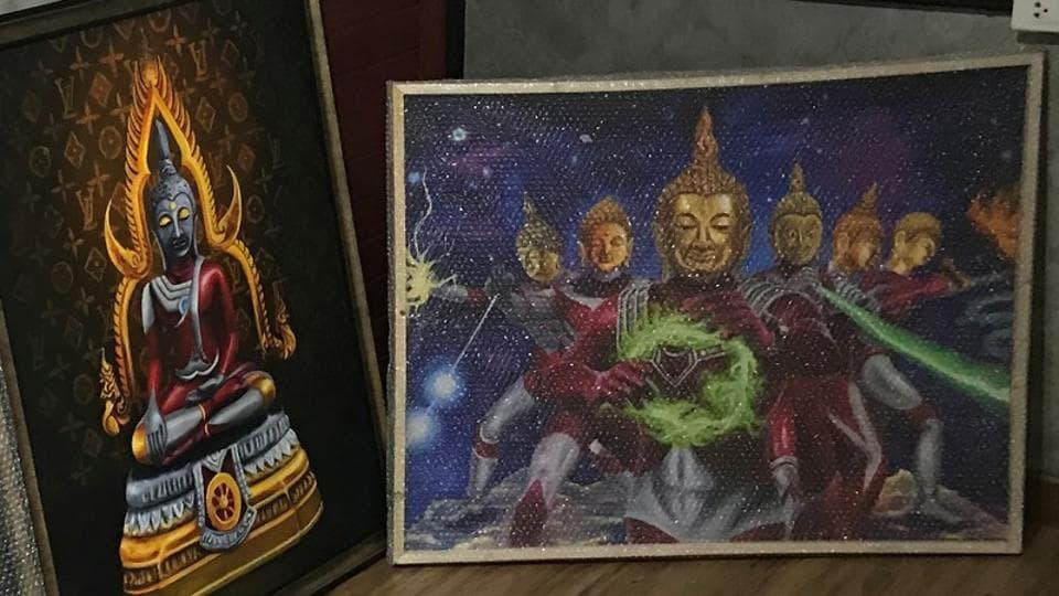 Paintings of Japanese superhero 'Ultraman' with Thai-style Buddha's head are seen in Bangkok.