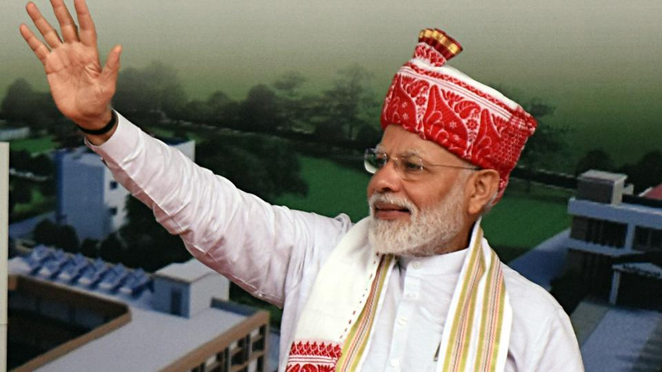 Prime Minister Narendra Modi waves to the crowd after inauguration of the new Vidhan Sabha complex in Ranchi on Thursday.