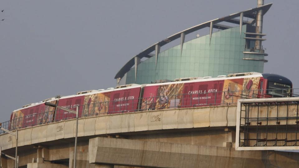 A Rapid Metro train running on its tracks at near Cyber City, in Gurugram.
