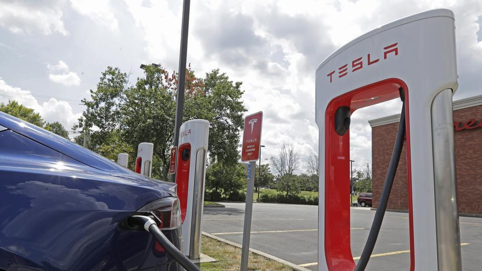 Tesla vehicle charges at a Tesla Supercharger site in Charlotte, N.C.