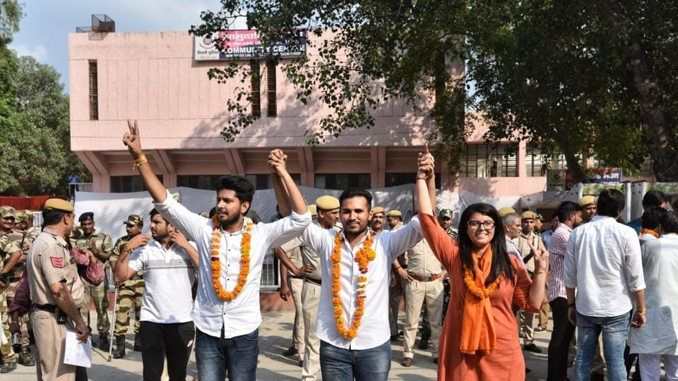 (L-R) ABVP candidates Pradeep Tanwar (vice president) , Akshit Dhaiya (president) and Shivangi Kharwal (Joint Secretary) posing for photographs after winning the DUSU elections at Police lines Kingsway Camp.