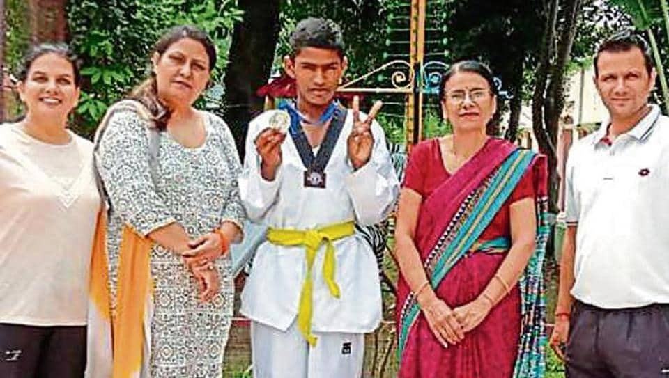 Krishan Kumar, a student of Class 7, won a silver medal in the under-14, below 57kg weight category.