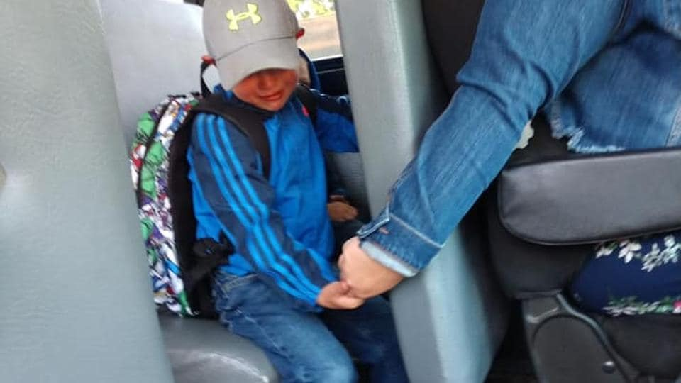 The boy featured in the picture is four-year-old Axel and th bus driver is Miss Lane.