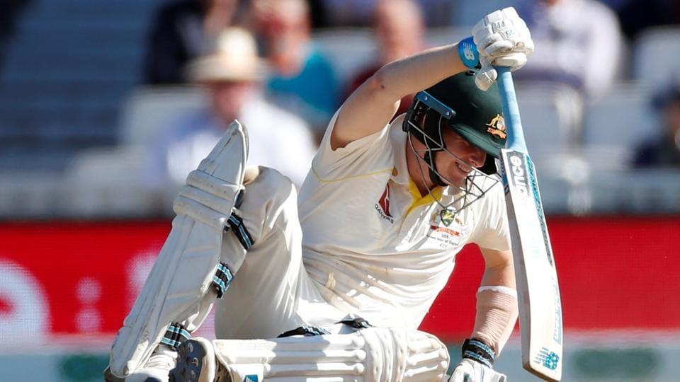 Australia's Steve Smith falls down.