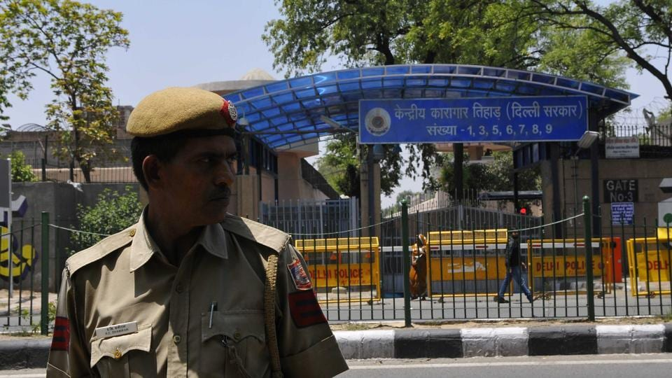 Security personnel guards the Gate No. three of Tihar Jail in view of protest by AAP party suppoters in New Delhi.
