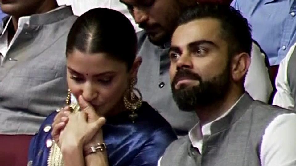 Anushka Sharma kisses her husband Virat Kohli's hand at a special event in New Delhi.