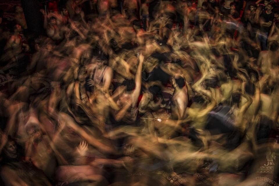 Iraqi Shiite Muslims take part in commemorations marking the 8th day of Muharram ahead of Ashura, in the southern city of Basra. - The religious commemoration of Ashura, which includes a ten-day mourning period starting on the first day of Muharram on the Islamic calendar, commemorates the seventh-century slaying of Prophet Mohammed's grandson Imam Hussein in Karbala. (Hussein Faleh / AFP)