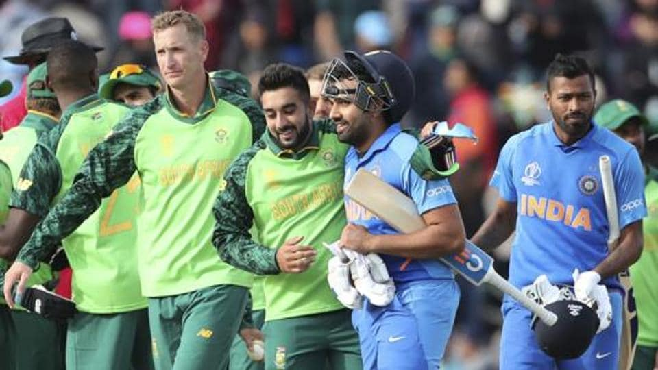 South Africa's Tabraiz Shamsi congratulates Rohit Sharma after India's win at the 2019 Cricket World Cup.