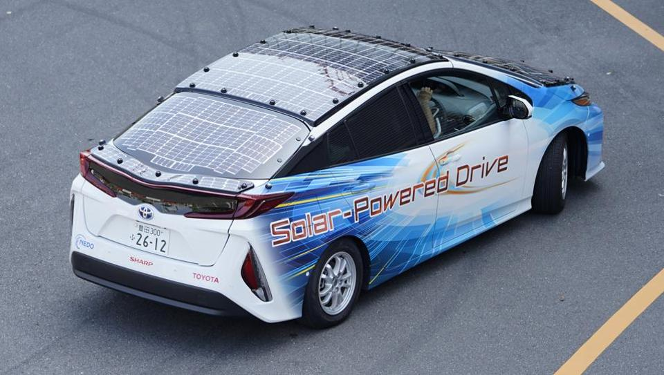 A Toyota Motor Corp. Prius PHV plug-in hybrid vehicle equipped with a solar charging system.