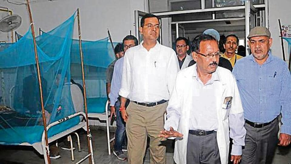 Doctors inspect a dengue ward at the Government Doon Medical College.