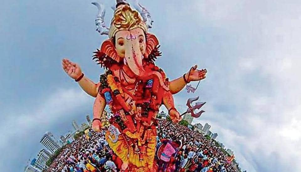Devotees in a procession to immerse idols of Ganesha in the Arabian Sea in Mumbai on Thursday.
