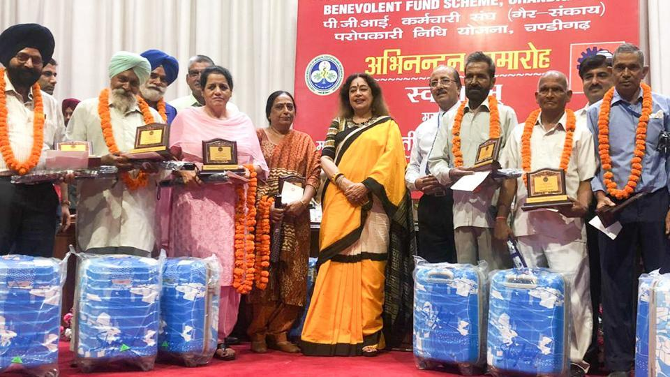 MP Kirron Kher and PGI director Dr Jagat Ram at a farewell function organised for the retired employees of the Postgraduate Institute of Medical Education and Research on Friday.