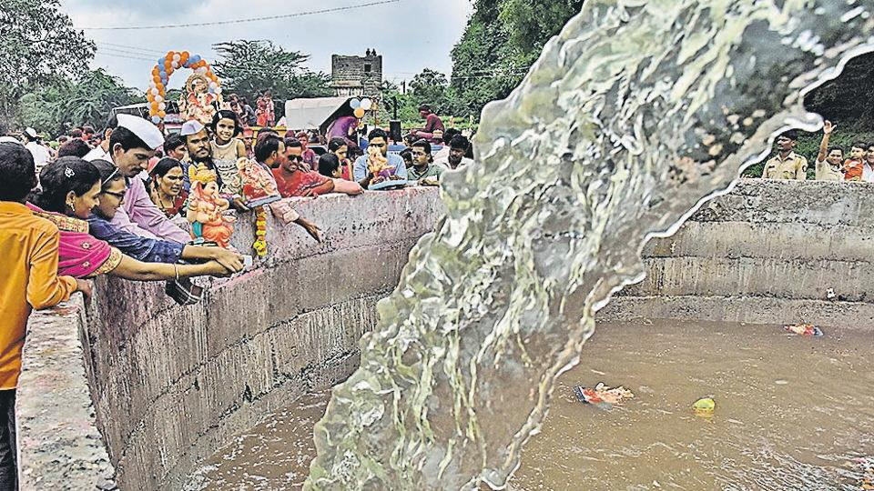 Ganpati immersion at a well in Kankaleshwar temple in Beed on Thursday, September 12. Water had to be pumped into the well for the occasion.