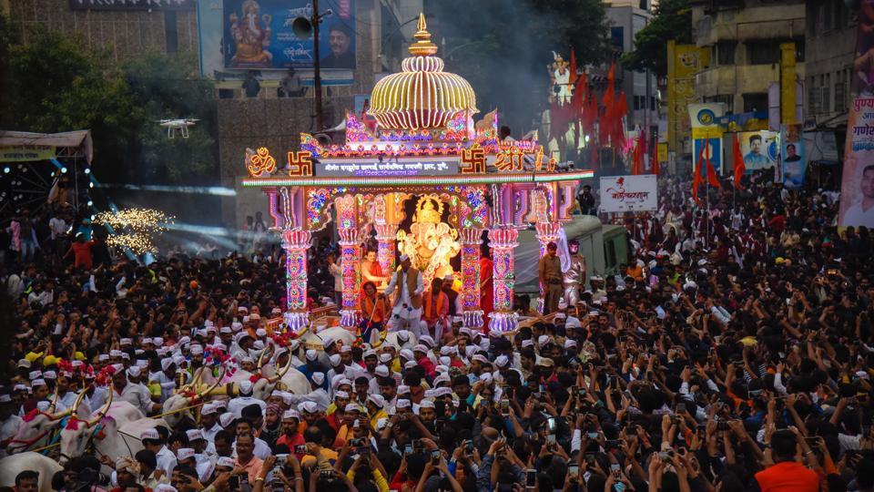 Ganpati immersion procession of Dagdusheth Halwai Ganpati Mandal at Alka talkies chowk on Thursday.