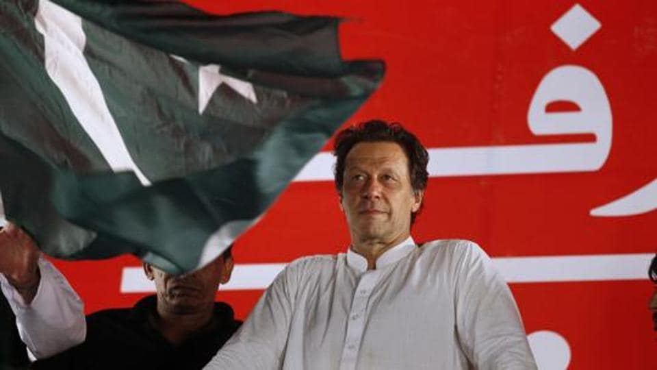 In this Saturday, July 21, 2018 file photo, Pakistani politician Imran Khan, chief of Pakistan Tehreek-e-Insaf party, arrives to address an election campaign rally in Islamabad.
