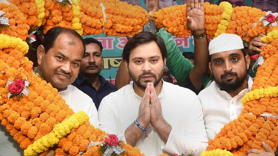 Rashtriya Janta Dal and leader of opposition Tejashwi Yadav being garlanded by supporters during a party membership drive function in Patna , Saturday, Sept. 14, 2019.