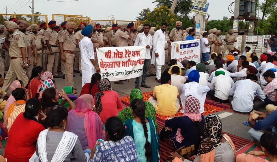 Police try to keep the protesting members of the Unemployed BEd Teachers' Union away from Punjab education minister Vijay Inder Singla's residence in Sangrur on Sunday.