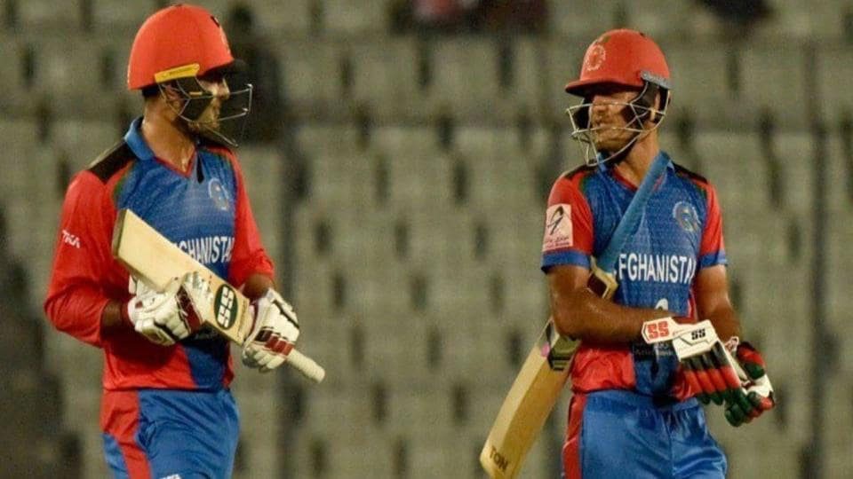 Afghanistan's Mohammad Nabi (L) and Najibullah Zadran (R) hit 7 sixes off 7 balls