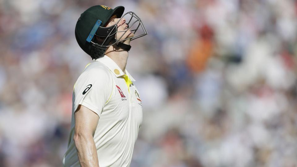 Australia's Steve Smith leaves the pitch after he is caught by England's Ben Stokes.