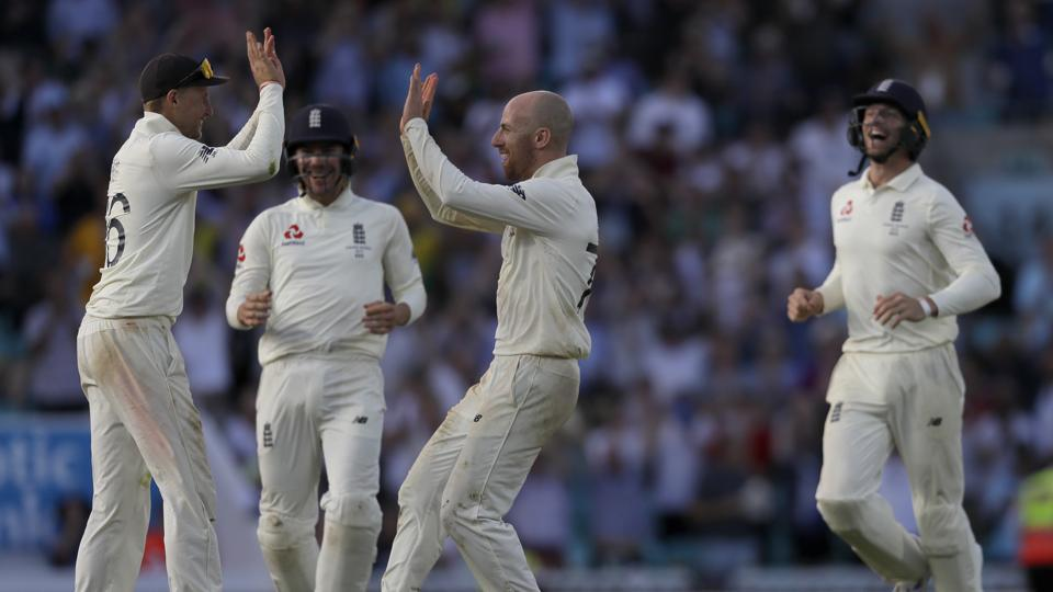 England's Joe Root, left, celebrates with teammates after winning the fifth Ashes Test.