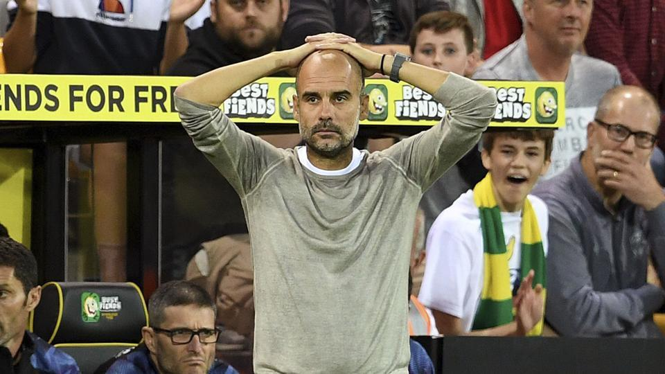 Manchester City manager Pep Guardiola looks dejected.