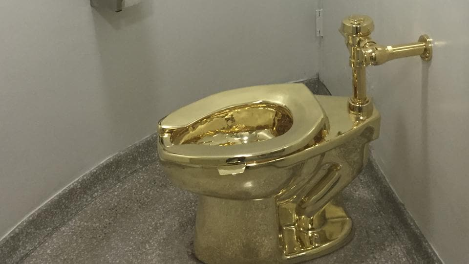 In this file photo taken on September 15, 2016, a fully functioning solid gold toilet, made by Italian artist Maurizio Cattelan, is going into public use at the Guggenheim Museum in New York. - Thieves have stolen an 18-karat gold toilet from an exhibition of artworks at Britain's Blenheim Palace, police said Saturday -- causing signficant flooding. The fully-functioning piece by Italian artist Maurizio Cattelan, dubbed