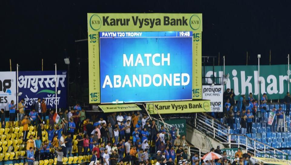 An electronic screen reads, 'match abandoned' at Himachal Pradesh Cricket Association stadium.