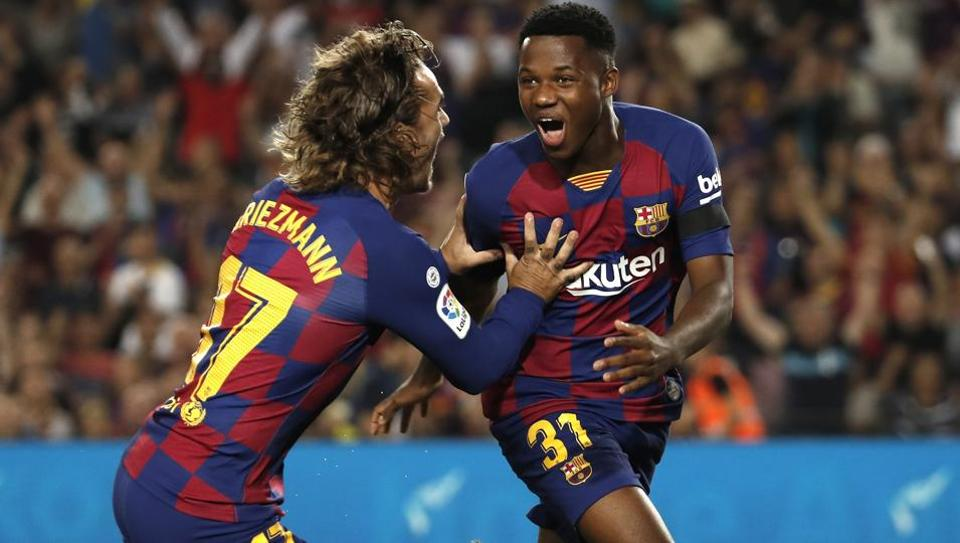 Barcelona's Ansu Fati, right, celebrates with teammate Barcelona's Antoine Griezmann