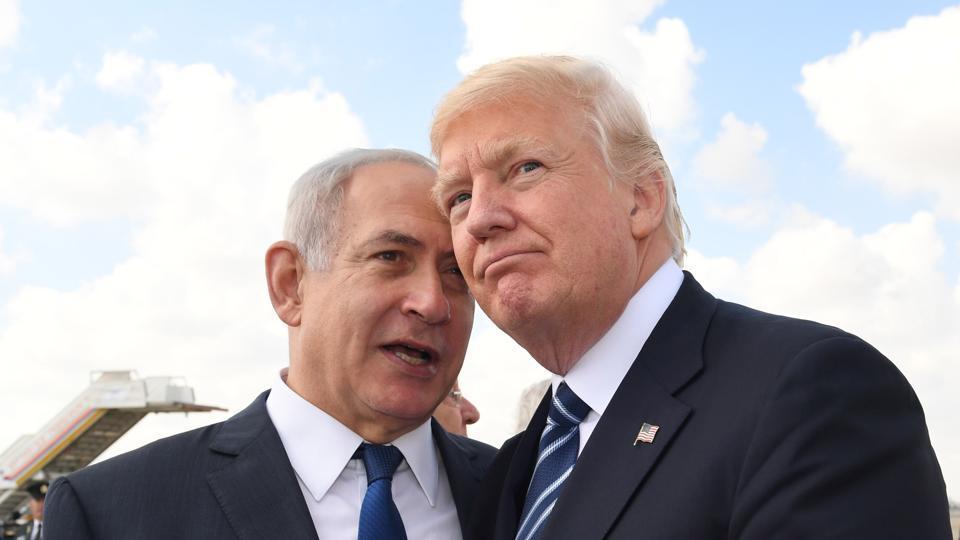 Israeli Prime Minister Benjamin Netanyahu speaks with US President Donald Trump prior to the President's departure from Ben Gurion International Airport in Tel Aviv in 2017.
