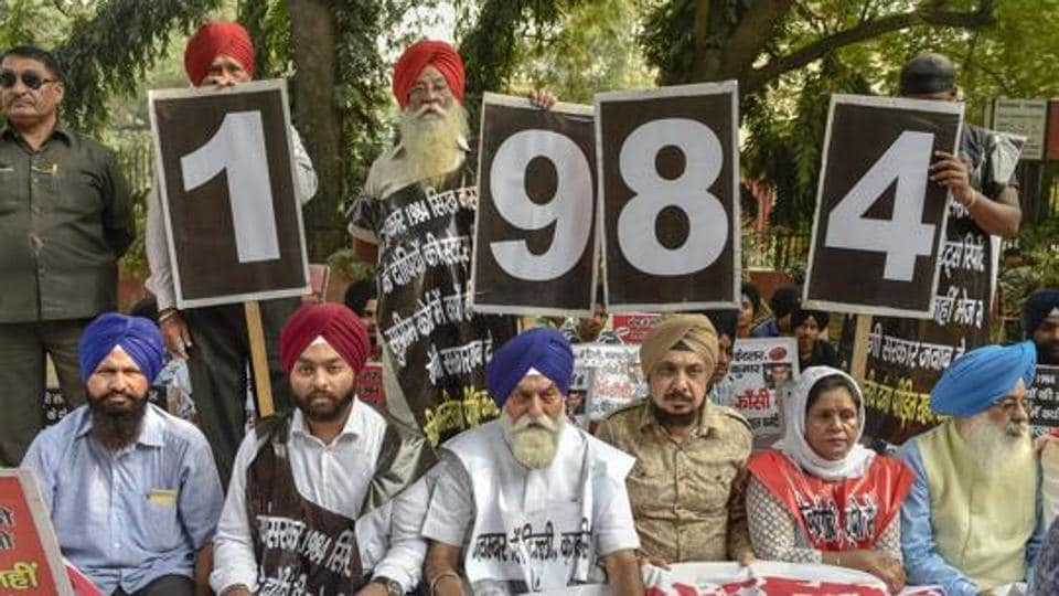 Family members of the victims of 1984 anti-Sikh riots stage a protest at Jantar Mantar, in New Delhi, Thursday, Nov 1, 2018.