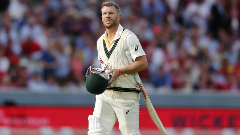 Australia's David Warner leaves the pitch after he is bowled by England's Stuart Broad.