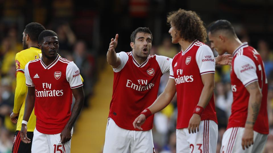 Arsenal's Sokratis Papastathopoulos, center, shouts at his teammates during their English Premier League match against Watford.